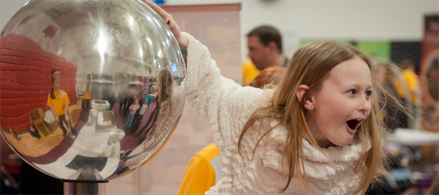 Touching a Van de Graff generator