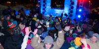 Students dance to music provided by Sound and Lighting Services in a snow-supported       sound system, during the annual All-Nighter.