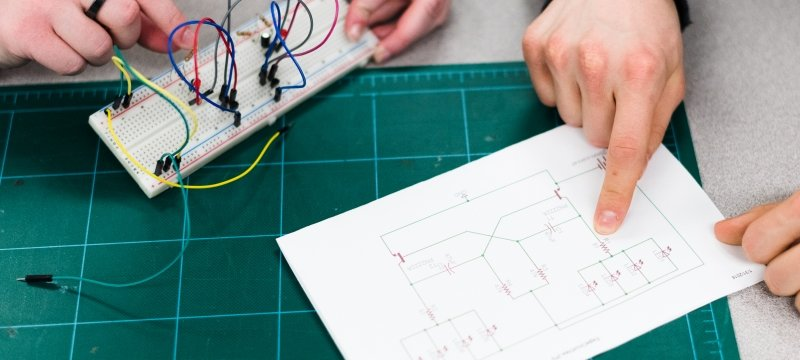 Electrical engineering student reading schematics.