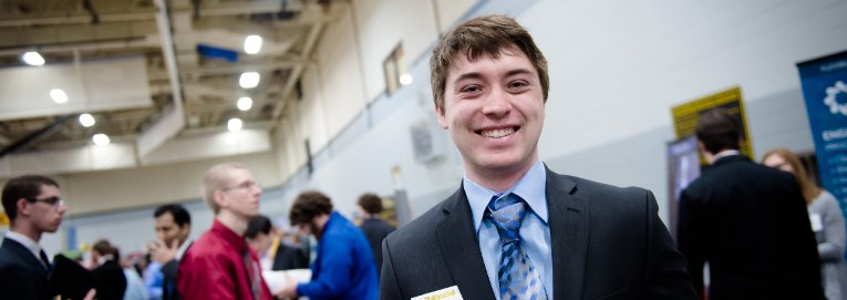 Student smiling at career fair