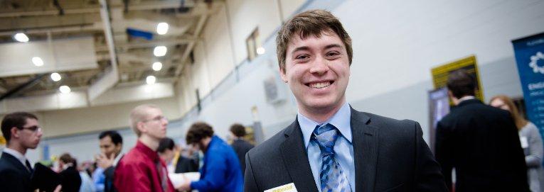 Student smiling at career fair