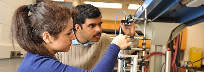 Students working with research equipment