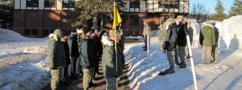 Cadets face student leadership on a sunny day in winter outside the ROTC building in miliary jackets and fatigues