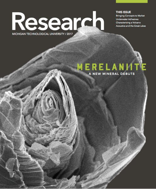 The cover of the most recent Michigan Tech Research magazine: a microscope view of a new mineral.