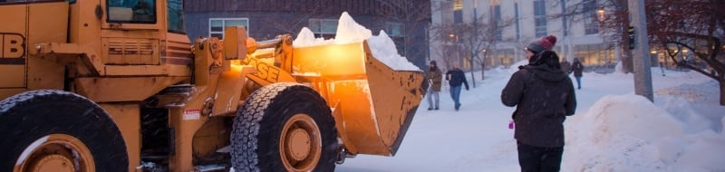 dump truck on campus moving snow