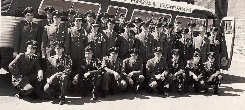 Cadets posing in front of a College of Mining Bus during the 1950-1960s