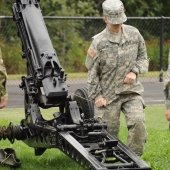 Cadet pullling cannon cord and kneeling