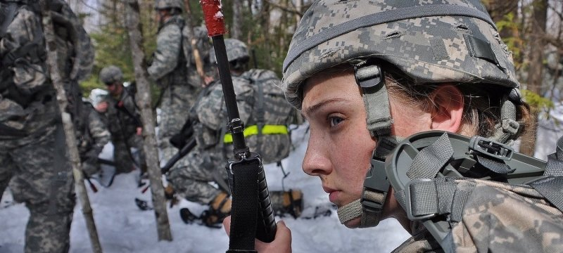 Cadets in the woods in winter, female cadet in the foreground
