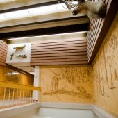 Images carved in wood and stuffed animals on the walls in the Noblet Building.