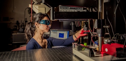 Biomedical Engineering student working with lasers.