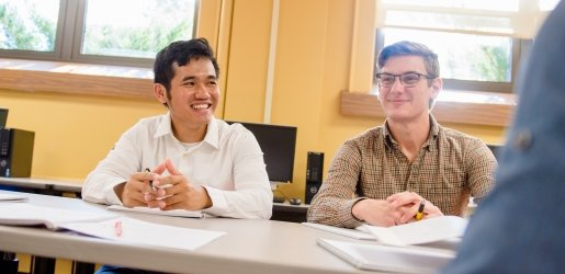 Two students sitting at a table.