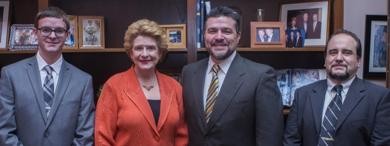 tudent Jerrid Burdue, Debbie Stabenow, Dean Johnson and Emanuel Oliviera posing and smiling