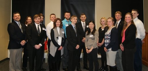 Group photo of the Beta Gamma Sigma students, their advisor, and the dean