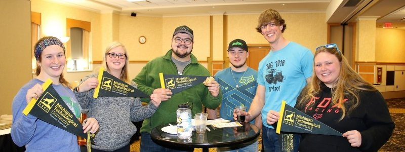 Six alumni with MTU pennants in Career Center