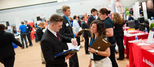 Students and employers talking during the Career Fair.