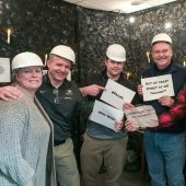 "Executive team in the escape room holding signs that say ""failed"" and ""not as crazy smart as we thought"""