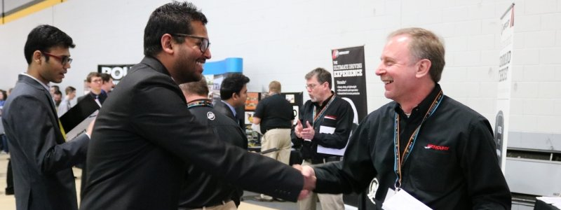Student shaking hands with recruiter at Career Fair