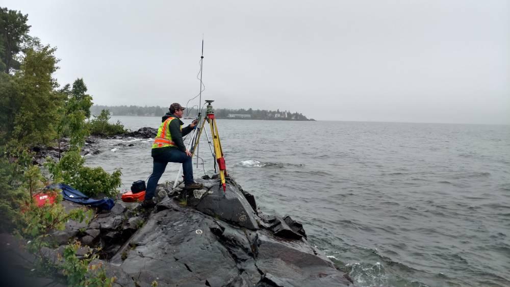 Geospatial engineers work on site.