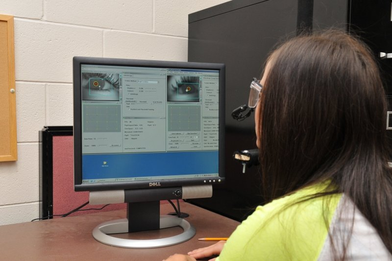 Student interacting with Eye Tracker