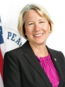 Portrait photo of Carrie Hessler-Radelet