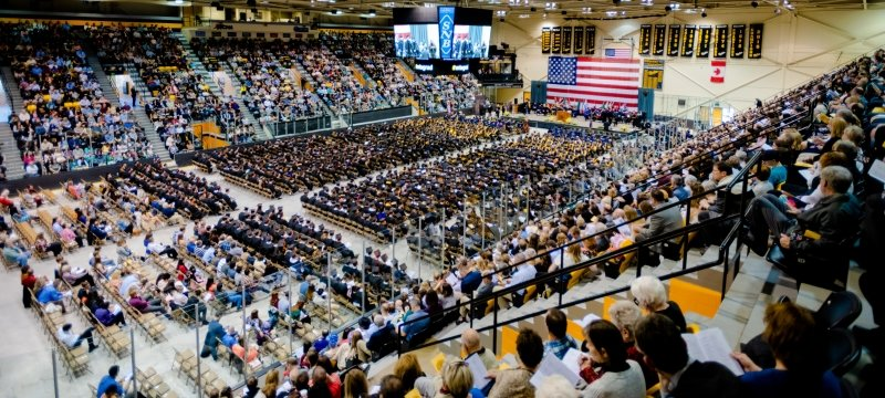 Wide view of the ice arena during commencement.