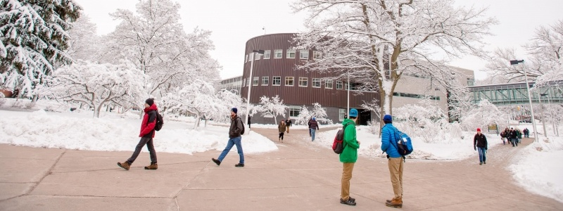 Michigan Tech's campus, by Rekhi Hall, during the winter.