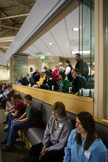 Patrons in a hockey suite.