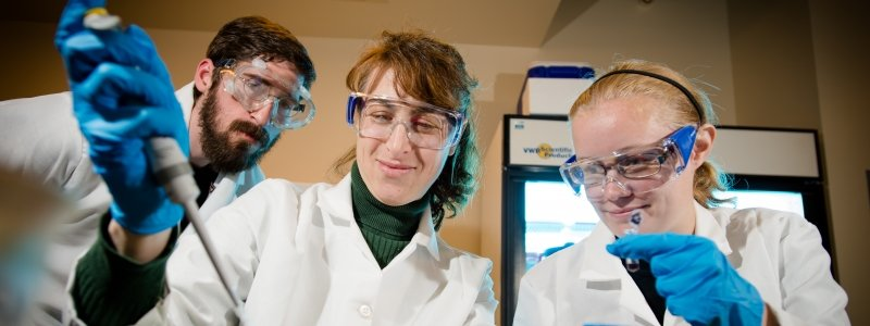 Researchers demonstrating proper safety attire in a lab.