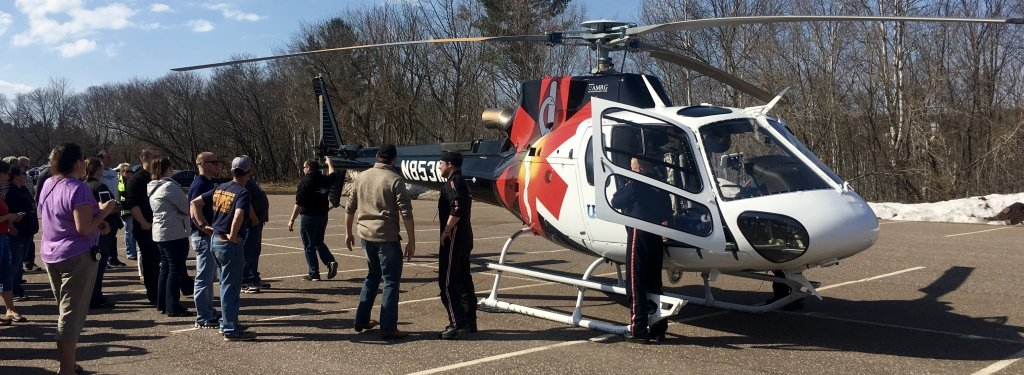 Trainees standing around an EMS helicopter