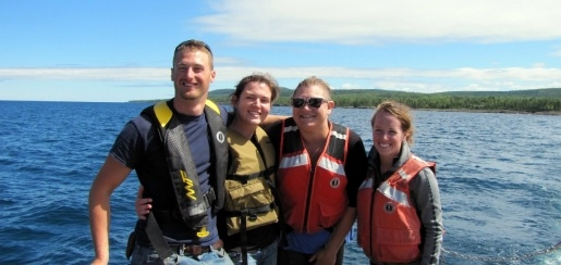 Engineering students on a boat, wearing lift vests.