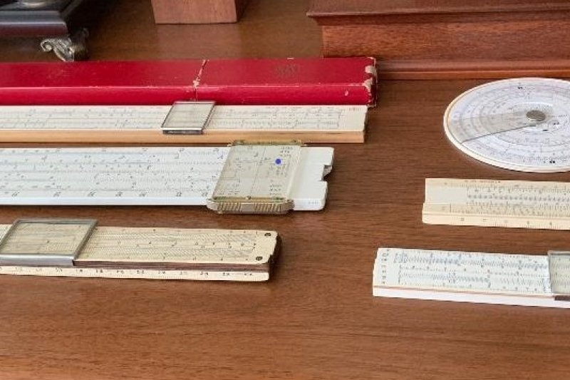 Array of slide rules on a table.