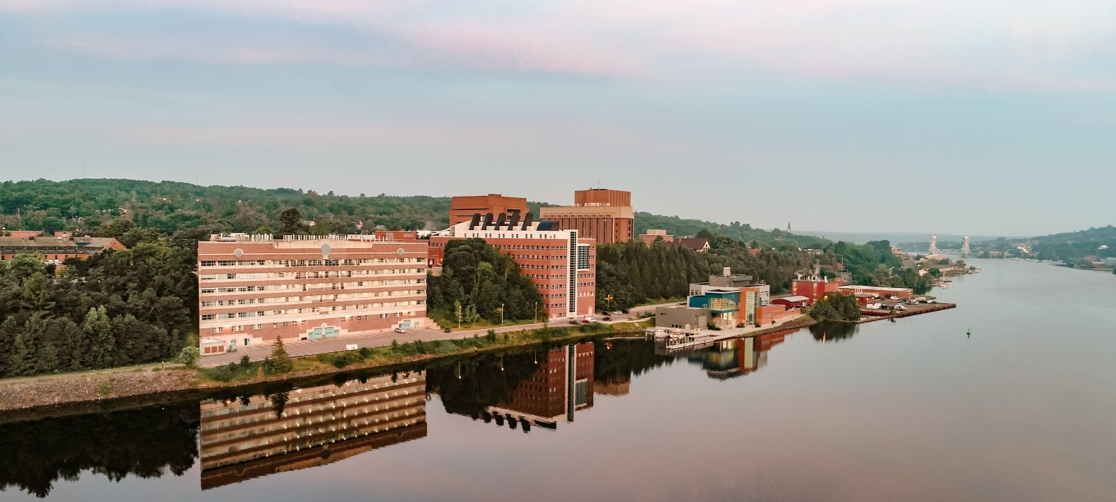Michigan Tech campus drone view in morning from Keweenaw Waterway.