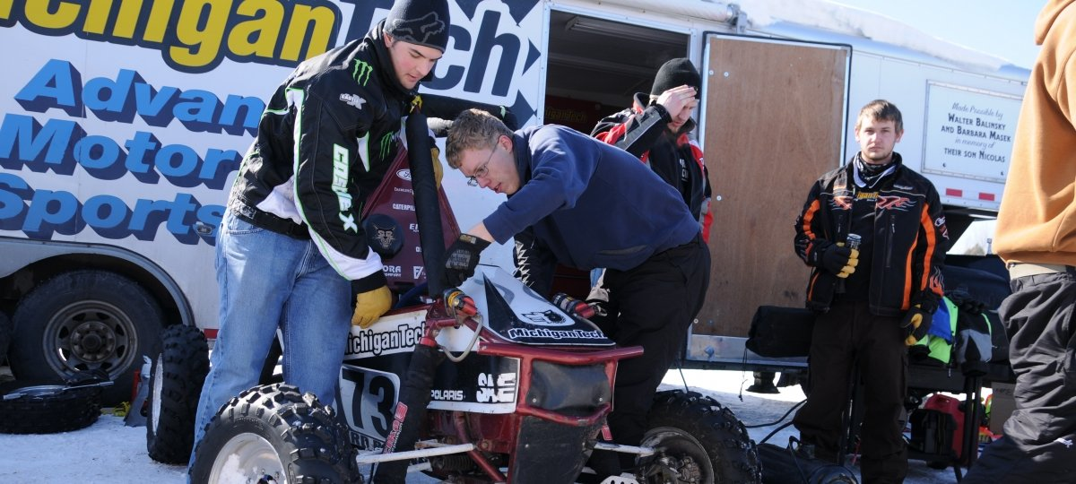 Michigan Tech students work on a baja racer