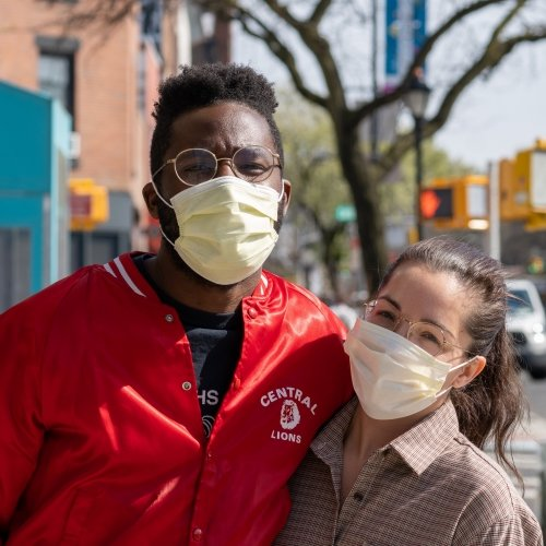 A couple, both wearing masks