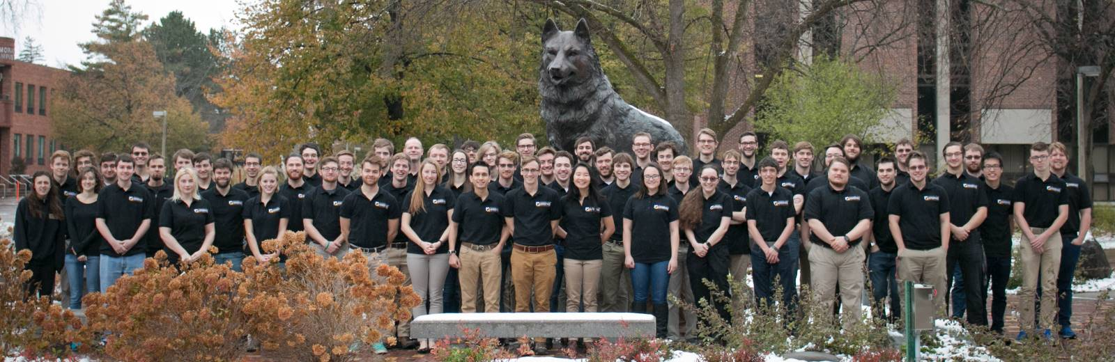 Aerospace Enterprise in front of the Husky Statue