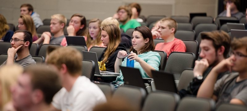 Students sitting in a lecture in Fisher 135