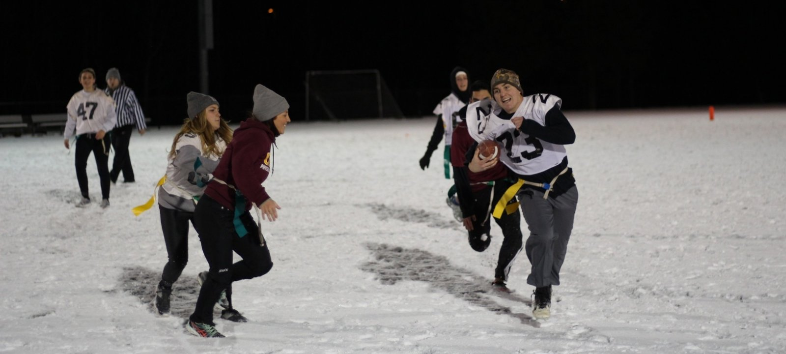 Michigan Tech Students playing flagg football in snow