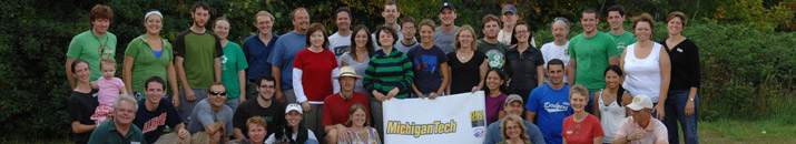 Graduate students with a michigan tech flag