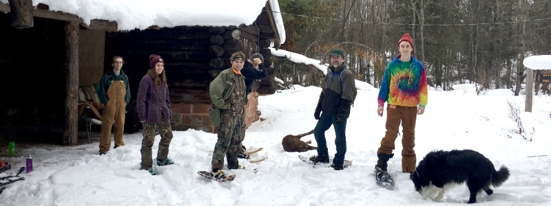 A group of students at the Otter River Cabin in the winter.