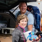 Parents unload a minivan during move-in weekend.