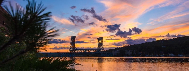 The sun sets behind the Portage Lake lift bridge.