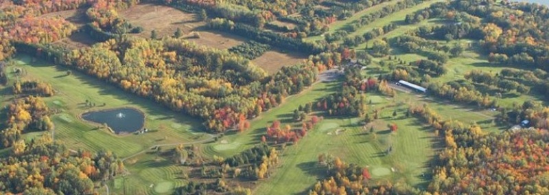 Aerial of the Portage Lake Golf Course during a sunny fall day.