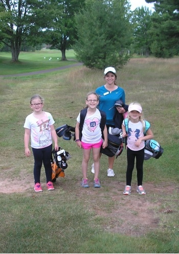 Junior golfers with an instructor.