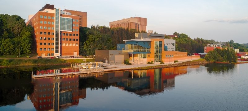 A view of campus from the Portage Canal in the early morning