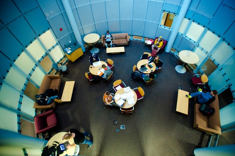 Students inside circular lounge room