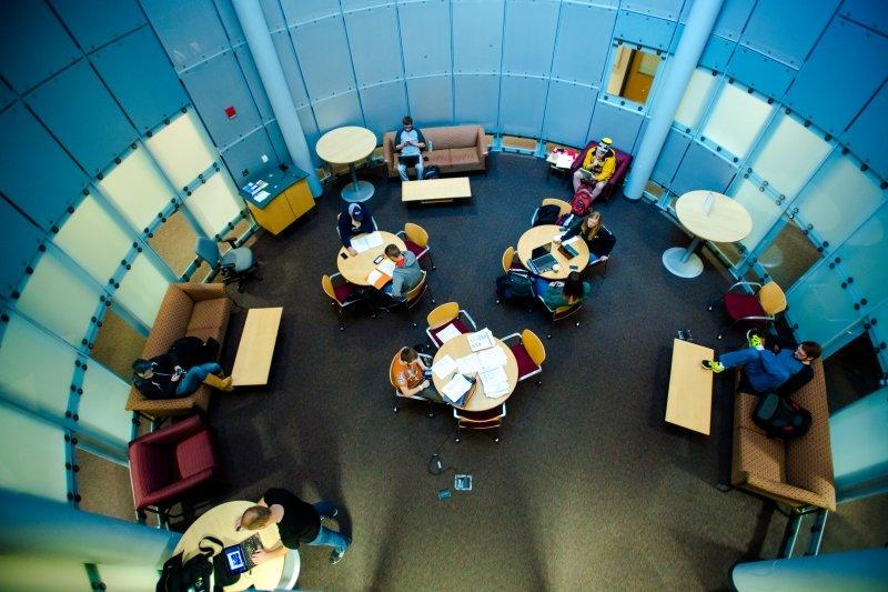 Students inside circular lounge room