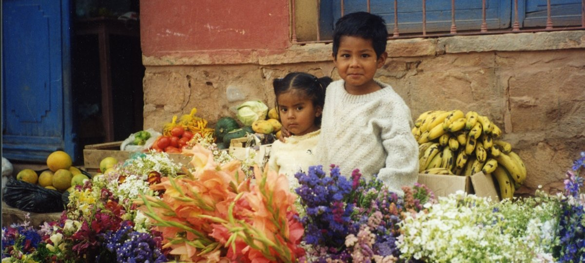 Two children at a street-side stall in Bolivia
