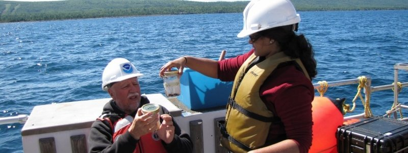 Researchers collecting samples on Lake Superior.