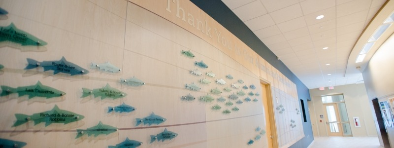 Engraved fish on the main hallway in the GLRC with Thank you text above.