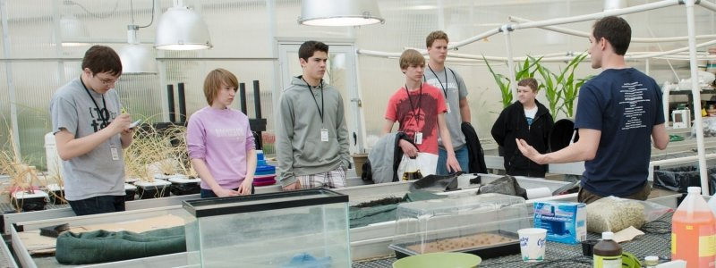 Students in a plant laboratory with an instructor explaining